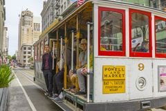 Passenger riding on a famous San Francisco cable car Royalty Free Stock Photos