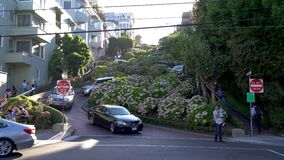 Cars driving through Lombard Street in San Francisco, USA