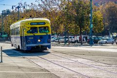 A blue and yellow tramway in San Francisco, California royalty free stock photography