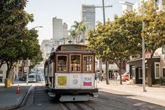 Traditional tram cars cable car on the streets of San Francisco, California, USA royalty free stock photography