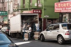 Workers unload goods from a truck in Chinatown in San Francisco, California, USA stock image