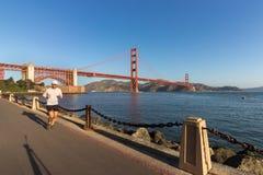 Jogging at Marine Dr, Golden Gate Bridge. San Francisco, California, USA - September 15th, 2017: A man is jogging on the Marine Dr road, The Golden Gate Bridge Stock Image