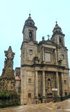 San Francisco church, Santiago de Compostela, Spain. Two Bell towers and facade of San Francisco church and Francis of Assisi sculpture near in Santiago de Royalty Free Stock Photography