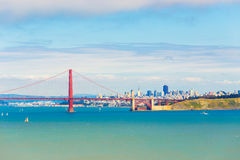 San Francisco City Golden Gate Bridge Distant View. Distant telephoto landscape view over ocean water through Golden Gate Bridge to San Francisco Cityscape under Stock Image