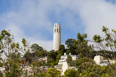 San Francisco cityscape - Coit Tower. SAN FRANCISCO - June 29 2012: Coit Tower is one of the most famous landmark in San Francisco Financial center Royalty Free Stock Photo