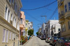 San Francisco - Colourfull Houses. Tangle of electrical wires in a street of san francisco Royalty Free Stock Images