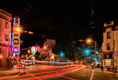 San Francisco - Condor Club and Transamerica Pyramid. A vivid red light district nighttime view of the landmark Condor Topless A Go-Go club, one of several such Stock Image