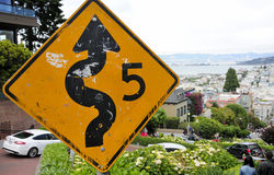 San Francisco Crooked Street. The weathered 5 MPH Lombard crooked street traffic sign at the top of the road in San Francisco California royalty free stock photography