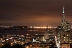 San Francisco downtown and Bay Bridge. A shot of downtown San Francisco and Bay Bridge on a cloudy night Royalty Free Stock Photos