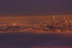 San Francisco downtown and Bay Bridge. Bay Bridge and San Francisco downtown in thick fog Royalty Free Stock Image