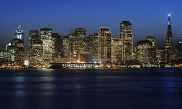 San Francisco Downtown in Chri. A view of San Francisco downtown decorated by Christmas lighting at dusk (shot from Treasure Island). Copyspace on top and bottom Royalty Free Stock Photo