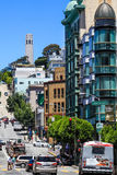 San Francisco Downtown Coit Tower. A view of Coit Tower up on Telegraph Hill from Kearny Street in downtown San Francisco. Coit Tower is one of the main tourist Stock Photo