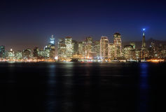 San Francisco Downtown at dusk. A view of San Francisco downtown decorated by Christmas lighting at dusk (shot from Treasure Island). Copyspace on top and bottom Royalty Free Stock Image