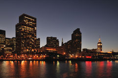 San Francisco Embarcadero Waterfront at night. With buildings all lit up and reflections off the bay stock photography