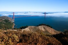 San Francisco Golden Gate bridge on foggy day dramatic evening l. San Francisco famous Golden Gate bridge on foggy day dramatic evening light view from Marin Stock Photography
