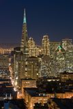 San Francisco Financial District at night. A shot of the San Francisco Financial District at night. Buildings are lit up for Christmas Royalty Free Stock Image