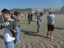 San Francisco Fleet Week. Spectators getting blasted by sand during the Marine landing during San Francisco Fleet Week Royalty Free Stock Images