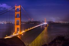 San Francisco golden gate bridge at night. Panoramic view over the San Francisco Golden gate Bridge and bay area at night sunset. Photo taken from Battery Stock Photo