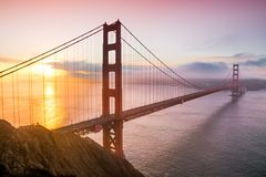 San Francisco golden gate bridge at sunrise. Panoramic view over the San Francisco Golden Bridge and bay area at down during sunrise. Photo taken from Battery Royalty Free Stock Photos
