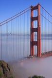 San Francisco Golden Gate Bridge in fog. Thic fog covering Golden Gate Bridge Stock Photo
