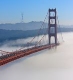 San Francisco Golden Gate Bridge in fog. Thic fog covering Golden Gate Bridge Stock Photos