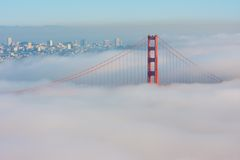 San Francisco Golden Gate Bridge in fog. Thic fog covering Golden Gate Bridge Stock Image