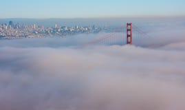 San Francisco Golden Gate Bridge in fog. Thic fog covering Golden Gate Bridge Stock Images