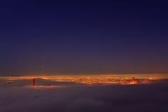 San Francisco Golden Gate Bridge in fog. Thic fog covering Golden Gate Bridge Royalty Free Stock Images