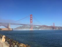San Francisco Golden Gate Bridge foggy mornings after surf Stock Photo