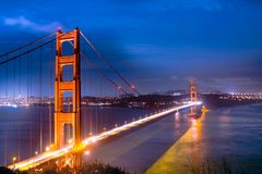 San Francisco golden gate bridge at night. Panoramic view over the San Francisco Golden gate Bridge and bay area at night sunset. Photo taken from Battery stock photography