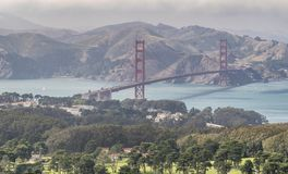 San Francisco Golden Gate Bridge and Sausalito mountain on backg. Round, aerial view from helicopter, California - USA Royalty Free Stock Image