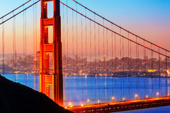 San Francisco Golden Gate Bridge sunrise through cables. San Francisco Golden Gate Bridge sunrise view through cables in California USA Stock Photos