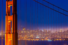 San Francisco Golden Gate Bridge sunset through cables Royalty Free Stock Photography