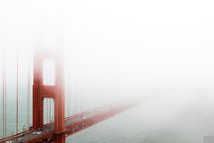 San Francisco, Golden Gate in the fog. San Francisco, California, USA, typical view of the red Golden Gate in the fog and mist Royalty Free Stock Images