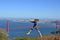 San Francisco, Golden Gate jump. Young man jumping high in front of the Golden Gate bridge in San Francisco. Image taken on a sunny day with the red bridge and Stock Images