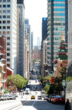 San Francisco High Street. Busy Commercial District in San Francisco leading down to the Bay Bridge in the background Stock Images