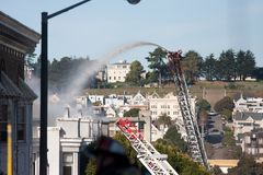 San Francisco - houses on fire. SAN FRANCISCO, CA - DECEMBER 22: Large fire of three apartment buildings in Western Addition district December 22, 2011 in San Stock Image