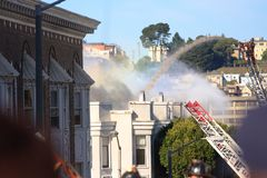 San Francisco - houses on fire. SAN FRANCISCO, CA - DECEMBER 22: Large fire of three apartment buildings in Western Addition district December 22, 2011 in San Royalty Free Stock Photos