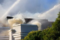 San Francisco - houses on fire. SAN FRANCISCO, CA - DECEMBER 22: Large fire of three apartment buildings in Western Addition district December 22, 2011 in San Royalty Free Stock Images