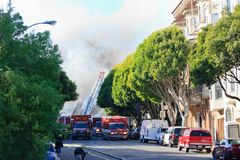 San Francisco - houses on fire. SAN FRANCISCO, CA - DECEMBER 22: Large fire of three apartment buildings in Western Addition district December 22, 2011 in San Stock Photo