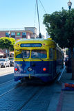 San Francisco muni railroad streetcar painted in yellow and blue colors Royalty Free Stock Photos