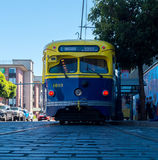 San Francisco muni railroad streetcar painted in yellow and blue colors Royalty Free Stock Photo