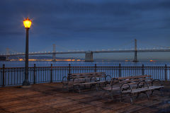 San Francisco at night - Bay Bridge. And harbour from Pier 7 Stock Photo