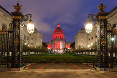 San Francisco Night Scene. Nighttime view of San Francisco City Hall illuminated by red light in honor of World AIDS Day Royalty Free Stock Photography