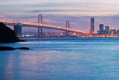 The San Francisco Oakland Bay Bridge. Brilliant twilight waters set off the San Francisco Oakland Bay Bridge and residential towers in San Francisco Royalty Free Stock Images