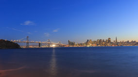San Francisco – Oakland Bay Bridge with lights at sunset time Royalty Free Stock Photography