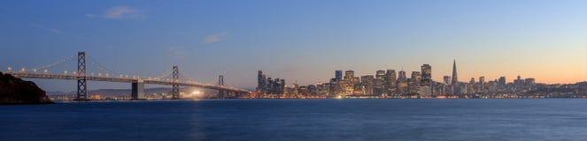San Francisco-Oakland Bay Bridge with lights at sunset time Royalty Free Stock Image