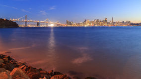 San Francisco-Oakland Bay Bridge with lights at sunset time Stock Photography