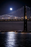 San Francisco-Oakland Bay Bridge at night. With the moon Royalty Free Stock Photo