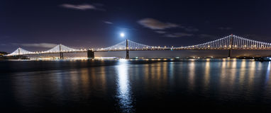 San Francisco-Oakland Bay Bridge at night. With the moon Royalty Free Stock Image